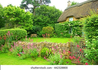 A Cotswold country garden in Summer time, Gloucestershire, England, UK