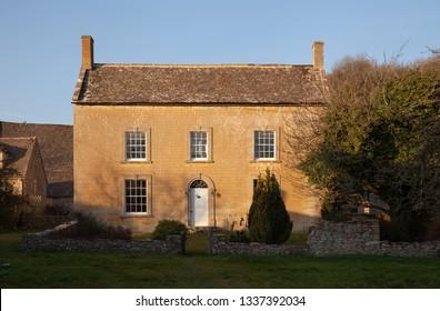 Cotswold stone farmhouse, Naunton village, Gloucestershire, England