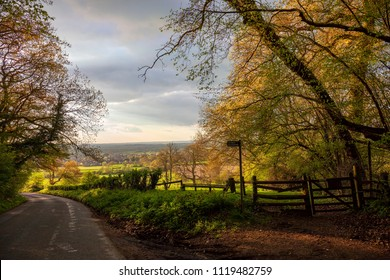 Cotswolds countryside with stile, Gloucestershire, England.