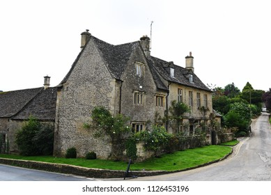 "Cotsworld UK - July 18, 2016: Typical Cotswolds village made with Cotswold stone. The name Cotswold is popularly attributed the meaning ""sheep enclosure in rolling hillsides""."