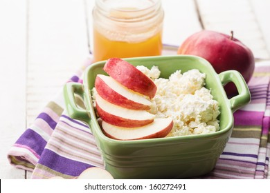 Cottage cheese, apples, honey. Rustic style. Bio/organic/natural ingredients. Healthy eating. Selective focus.