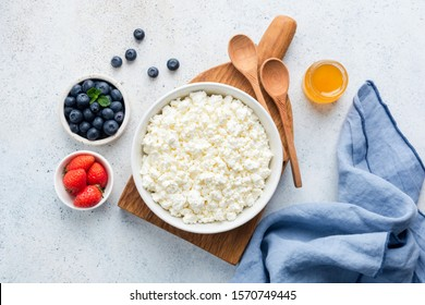 Cottage Cheese In Bowl. Homemade Curd Cheese Served With Fresh Berries Blueberry Strawberry And Honey. Fermented dairy product rich in Protein, healthy fats and Caclium