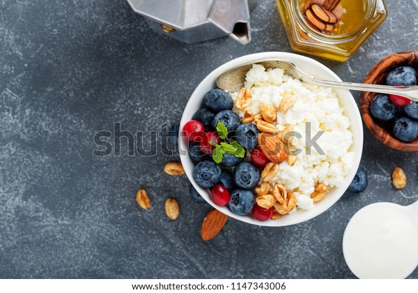 Cottage cheese for breakfast with granola, honey and blueberry.
