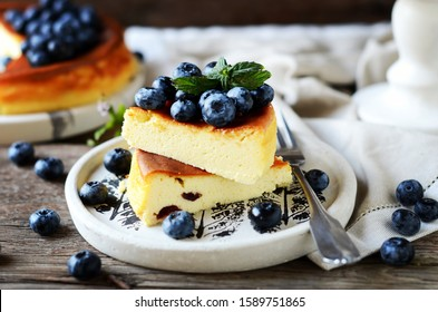 Cottage cheese casserole with blueberries on a wooden background