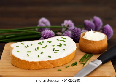 Cottage cheese and chives on slice of bread