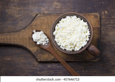 cottage cheese in a cup and spoon on Wooden tables