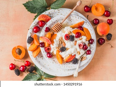 Cottage cheese with fruits, berries, honey and nuts. Italian ricotta cheese with fruits copy space directly above.