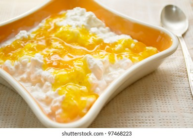 cottage cheese with jam in the orange bowl