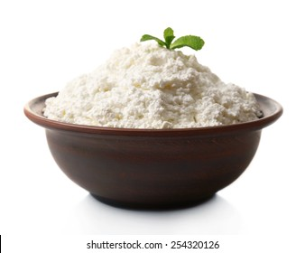 Cottage cheese with mint in clay bowl isolated on white