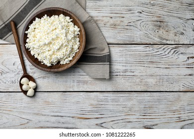 Cottage cheese and mozzarella on wooden background