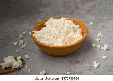Cottage cheese on napkin. Cheese on with wooden spoon. Healthy dairy product for breakfast. proper nutrition, dietary product