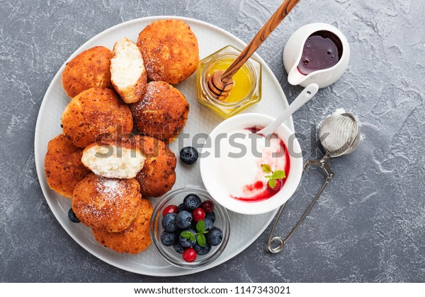 Cottage cheese pancakes with sour cream, blueberries and mint.