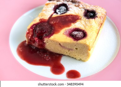 Cottage cheese pudding with cherries and fruit sauce. Closeup