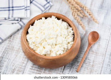 Cottage Cheese or Tvorog in bowl. Rich in Calcium healthy food, dairy product. On white wooden background. Closeup view