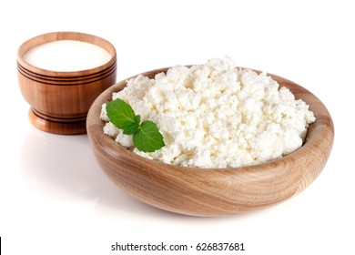 Cottage cheese in a wooden bowl isolated on a white background