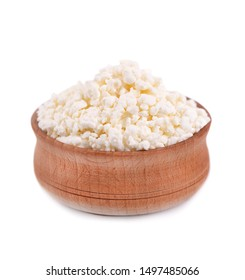 Cottage cheese in a wooden bowl and spoon isolated on white background.