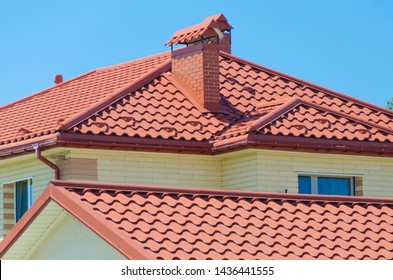 Cottage house with the red roof of module tile with high wave.