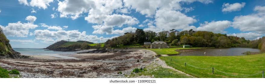 Cottage, lake and beach at Polridmouth Bay, near Fowey, Cornwall, UK.