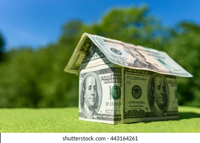 Cottage made of dollar banknotes, housing loan. Think green.