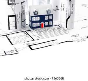 cottage plans and house model (real estate concept)