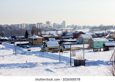 cottage settlement under construction on a frosty winter day