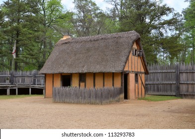 Cottage with stucco and thatch