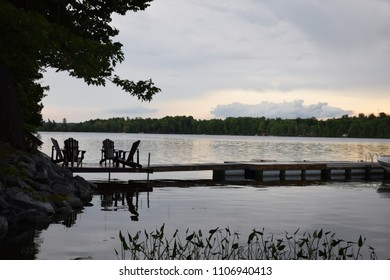 Cottage view - chairs on dock.