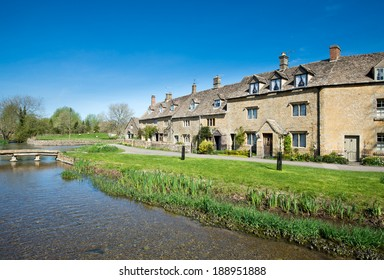 Cottages by a stream in the Cotswold village of Lower Slaughter