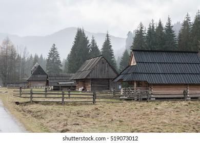 Cottages in a forest. Highlander house.