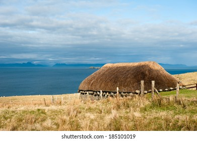 An cottages in the Island of Skye, Scotland, UK, in front of the sea