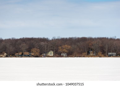 Cottages on a frozen lake