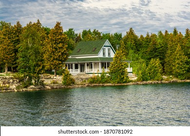 Cottages on lakeshore in Big Tub Harbor Tobermory Bruce Peninsula Ontario Canada on a sunny early autumn day