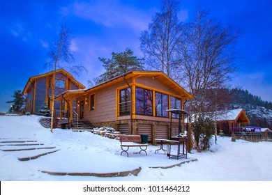 Cottages for rent in winter. Winter holiday homes. Cottages for rent in Karelia. Karelia places to relax. The village is on the background of a mountain.