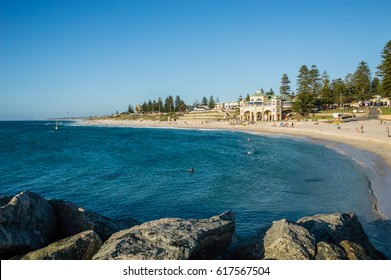 Cottesloe Beach and the Indiana Tea House with a clear blue sky. Cottesloe Beach is a popular location for tourists to visit in Perth, Australia.
