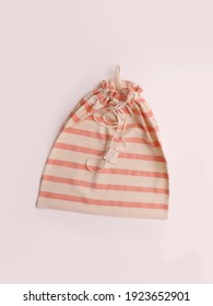 Cotton bag with pink stripes, top view on white background