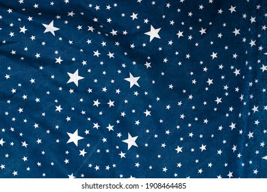 Cotton blue fabric in a white pattern of stars.