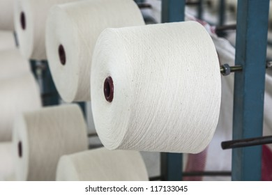cotton cone stacked in the rack in a yarn factory