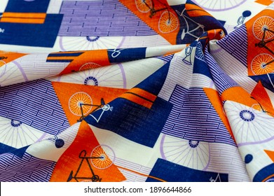 Cotton fabric, blue, yellow and white geometric shapes. With a drawn cycling theme, retro pattern. abstract mixing of bike parts