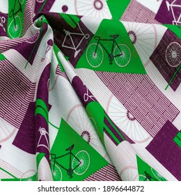 Cotton fabric, green, burgundy and white geometric shapes. With a drawn cycling theme, retro pattern. abstract mix of bike parts. Texture background drawing