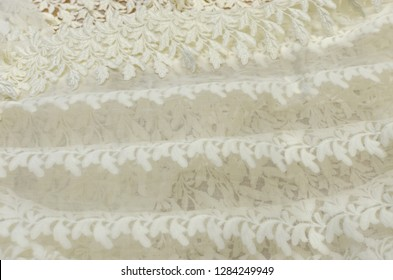 Cotton fabric, organza, embroidered with fringed macrame, ivory