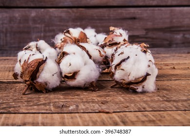 Cotton flowers on a wooden background