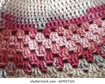 Cotton hand-knitted background texture with pink and grey color
