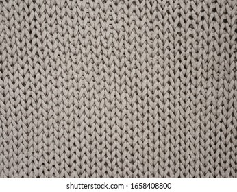Cotton handmade knitted large blanket, trendy concept. Close-up of knitted blanket, knit background