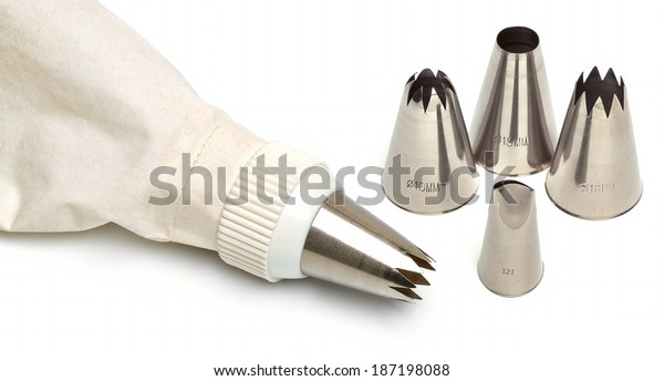 Cotton icing bag with pins or tips isolated on white background
