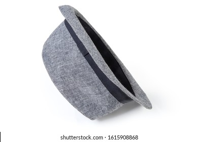 Cotton light gray men's hat with a soft medium brim in fedora style lies on its side on a white background