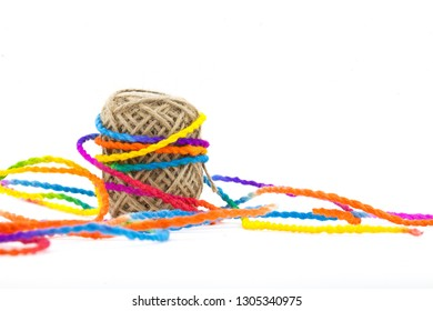 Cotton rope into a multicolor rope tied around on a white background-Image business concept has space