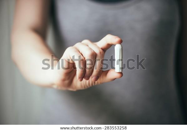 Cotton tampon, feminine hygiene product