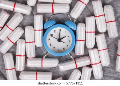 Cotton tampons with clock. Woman critical days, woman hygiene protection. Menstruation
