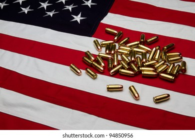 A cotton US flag with a pile of handgun ammunition / bullets