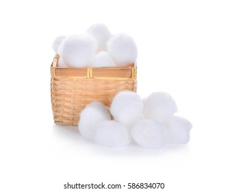 cotton wool in wooden basket isolated on a white background